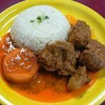 Cerdo trozado con arroz