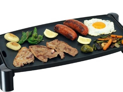 Ventajas de cocinar en una plancha for Cocinar pez espada a la plancha